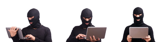 The hacker with computer wearing balaclava Royalty Free Stock Photos