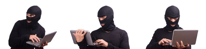 The hacker with computer wearing balaclava Stock Photos