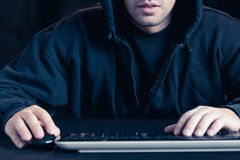 Hacker and computer Stock Image