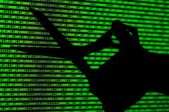 Hacker concept. computer binary codes and Hand scissors . Stock Photo