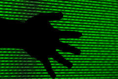Hacker concept. computer binary codes and Hands of thieves . Stock Images