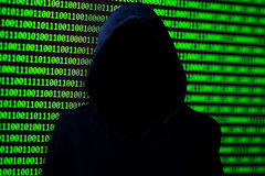 Hacker concept. Unrecognizable person in the hood. stock photo