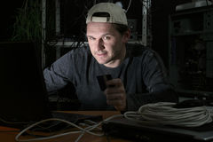 Hacker with credit card Stock Image