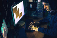 Hacker in the dark breaks the access to steal information Royalty Free Stock Photography