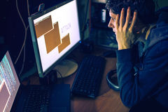 Hacker in the dark breaks the access to steal information Stock Photos