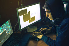 Hacker in the dark breaks the access to steal information Royalty Free Stock Photo
