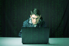 Hacker in the dark breaks the access to steal information Royalty Free Stock Image