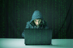 Hacker in the dark breaks the access to steal information Royalty Free Stock Images