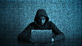 Hacker in data security concept. Hacker using laptop. Hacking the Internet. Cyber attack royalty free stock photo