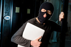 Hacker in a datacenter Royalty Free Stock Photos