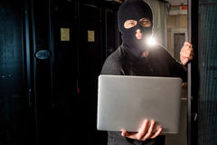 Hacker in a datacenter Stock Image