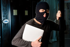 Hacker in a datacenter Stock Photo