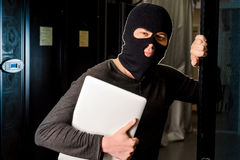 Hacker in a datacenter Royalty Free Stock Images