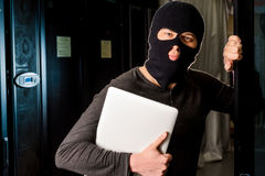 Hacker in a datacenter Royalty Free Stock Photo