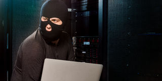 Hacker in a datacenter Stock Photography