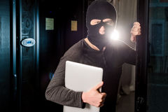 Hacker in a datacenter Stock Images