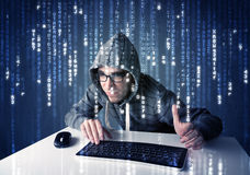 Hacker decoding information from futuristic network technology Stock Image