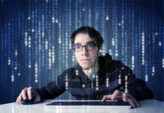 Hacker decoding information from futuristic network technology stock photography
