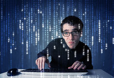 Hacker decoding information from futuristic network technology Stock Images