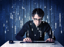Hacker decoding information from futuristic network technology Royalty Free Stock Images