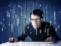 Hacker decoding information from futuristic network technology Royalty Free Stock Image