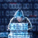 Hacker, der auf einem Laptop schreibt Stockfoto