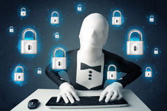 Hacker in disguise with virtual lock symbols and icons Royalty Free Stock Photos