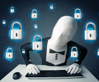 Hacker in disguise with virtual lock symbols and icons Stock Photos