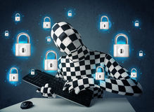 Hacker in disguise with virtual lock symbols and icons. On blue background Royalty Free Stock Image