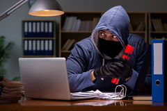 The hacker with dynamite stealing data Stock Photos