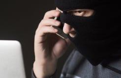 Hacker in einer Maske Lizenzfreies Stockbild