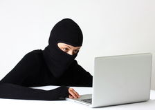 Hacker. Female hacker with laptop isolated on a white background Stock Images