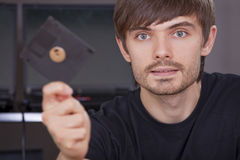 Hacker with floppy disk Stock Photography