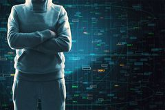 Malware and stock concept. Hacker with folded arms standing on dark background with forex chart. Malware and stock concept stock image