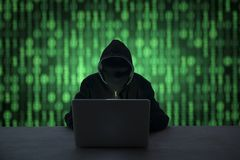 Hacker in front of his computer. Dark face stock photos
