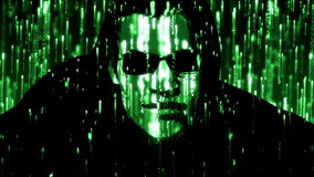 Hacker with glowing green code stock footage