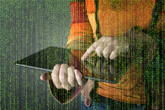 Hacker with graphic user interface around. Stock Image