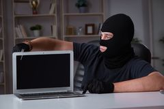 The hacker hacking computer late at night. Hacker hacking computer late at night Stock Photography