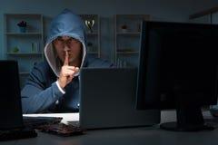 The hacker hacking computer at night Royalty Free Stock Photo