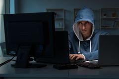 The hacker hacking computer at night Stock Images