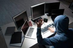 The hacker hacking computer at night Royalty Free Stock Photos