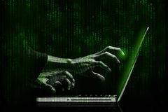 Hacker. Hands with binary codes on monitor Royalty Free Stock Photos