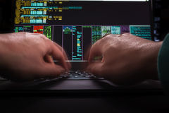 Hacker hands, first person view, at work with interface. Hacker hands at work with interface around Stock Images