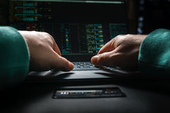 Hacker hands, first person view, at work with interface and stolen credit card. Stock Photo