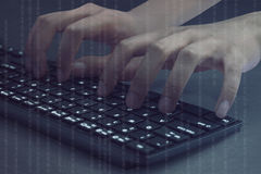 Hacker hands typing on computer keyboard Stock Images