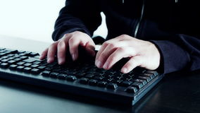 Hacker hands typing on computer keyboard stock footage