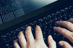 Hacker hands at work on a laptop. first person view. Hacker hands, first person view, at work on a code Royalty Free Stock Photo