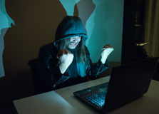 Hacker on his computer is going crazy, because he got cought Stock Photos