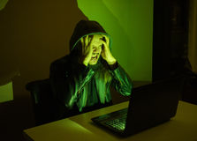 Hacker on his computer is going crazy because he got cought Stock Images