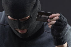 Hacker hold stolen credit card Royalty Free Stock Photo